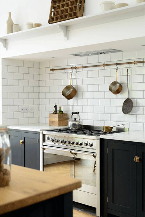It's a big call, dream kitchen, but the Arts and Crafts Kent Kitchen by London-based deVOL Kitchens is the stuff of my fantasies made real. From the shaker-style, dark blue cabinets to the white stone