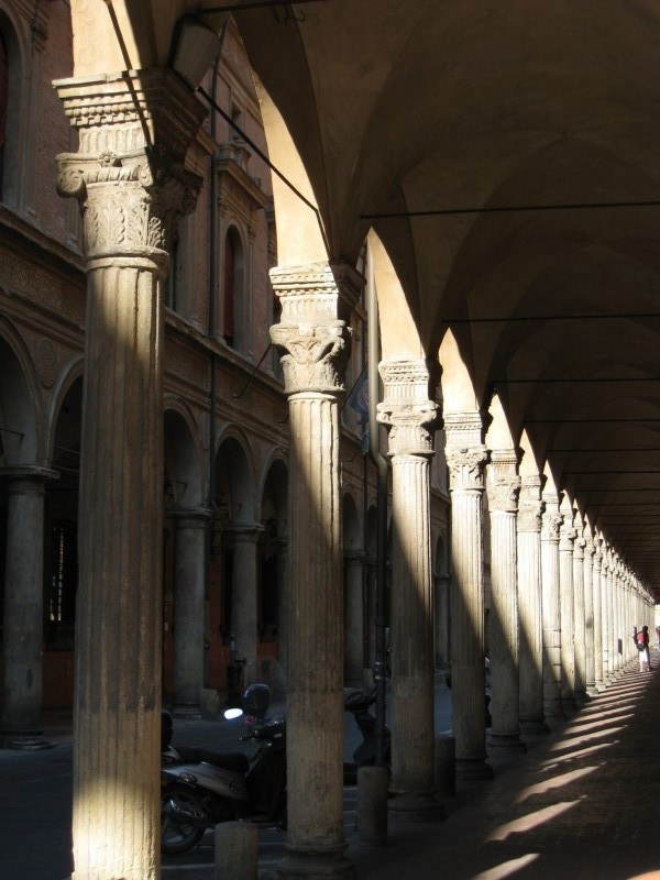 The arcaded streets of Bologna, Italy.  When it rained cats and dogs in Florence, I'd hop a train to Bologna to walk around and sketch and stay dry under all the porticoes and arcades.