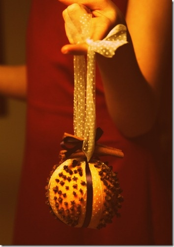 Pomander (clove studded orange). Cool English holiday tradition.