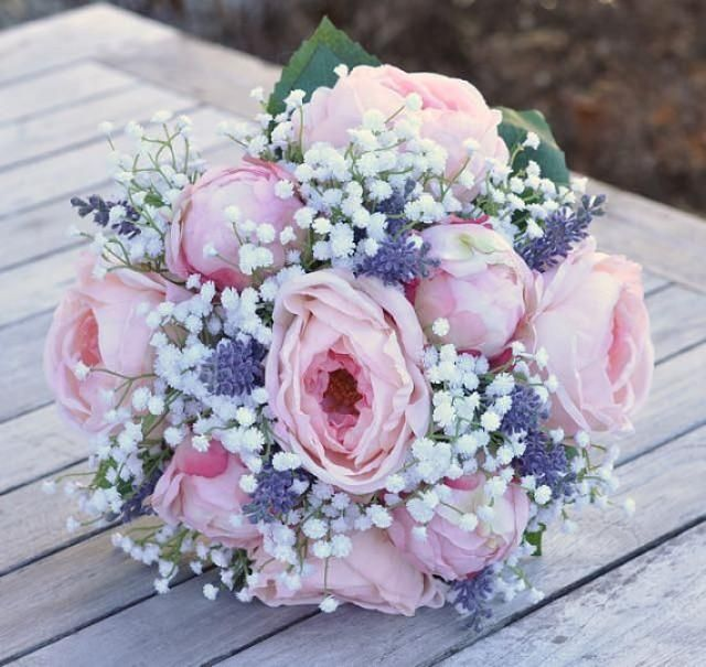 This bouquet is made with pink cabbage roses, pink peony buds, babies breath and Lavender silk flowers with white ribbon on the stems. This