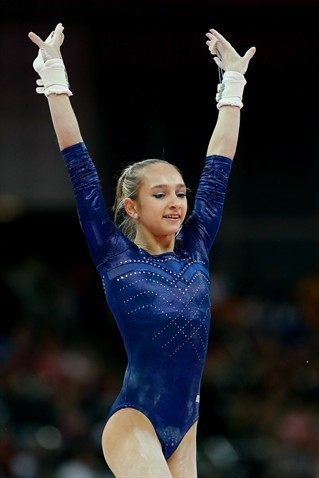 Victoria Komova of Russia my brother could not stop saying her funny name.she also looks likes she is 12