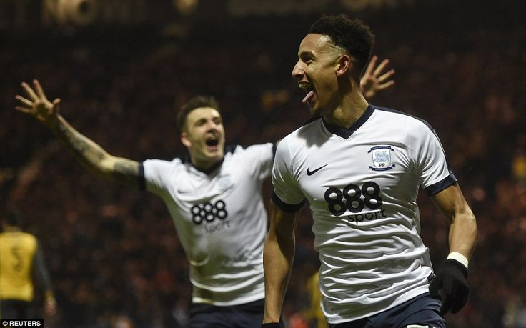 Robinson dashes off to celebrate excitedly after giving the Championship side a shock lead at Deepdale on Saturday evening