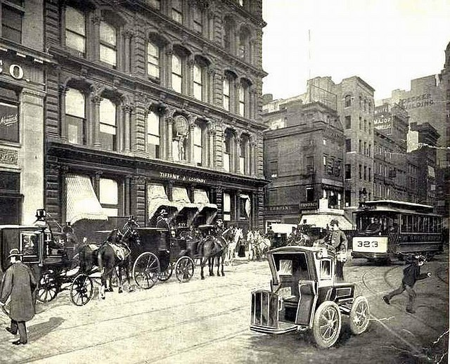 Tiffany's, Union Square, 1899. Note the bizarre early taxi bottom right: The body is the same as a Hansom Cab, just no horses. I've never encountered this hybrid in automotive history before! JC