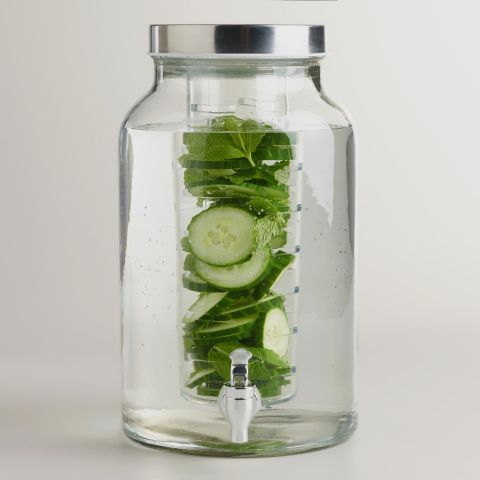 World Market Glass Infuser Dispenser Fill the cylindrical infuser compartment of this drink dispenser with flavorful fresh fruits, vegetables, or herbs without worrying about the spigot getting clogged as the liquid depletes. Try infusing beverages with fresh rosemary or thyme this winter.