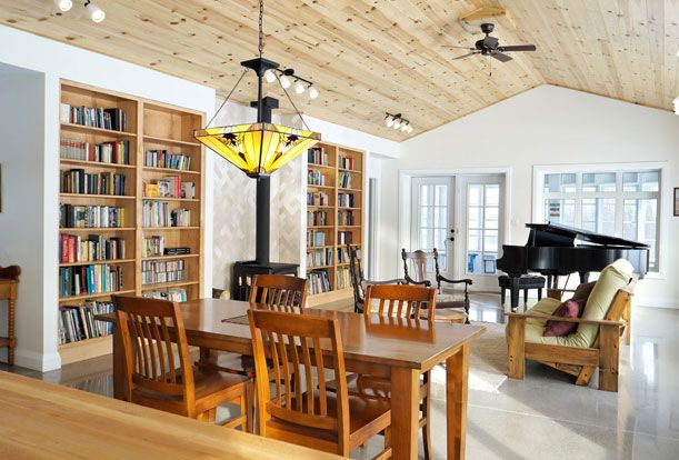 Great Room looking east towards the screened-in porch.  Passive Solar Design | Sustainable Building | Solares Architecture