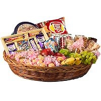 Grand Hamper –An excellent hamper to gift to, consisting of  a) Danish butter cookies,  b) Lays chips,  c)Cadbury celebration Pack,  d) 4 packs of dry fruits (raisins, almonds, pistachios, kaju),  e) 2kg fruits (apples, bananas, grapes etc),  f) 4 coke cans and  g) 2 packs of Britannia biscuits all beautifully decorated in a big carved bamboo basket. A grand gift indeed to make your dear ones feel that you care.