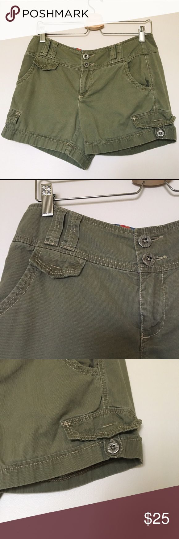 """Anthropologie Daughters of Liberation Green Shorts Unique, Cute, Functional Anthropologie Daughters of Liberation Army Green Shorts. Size 6. 100% Cotton. Excellent Condition. The buttons are so groovy!! Love them! Plus, the blue floral interior pattern is awesome. Machine wash cold with like colors. Waist W: 16"""" laying down. L: 12"""" Anthropologie Shorts"""