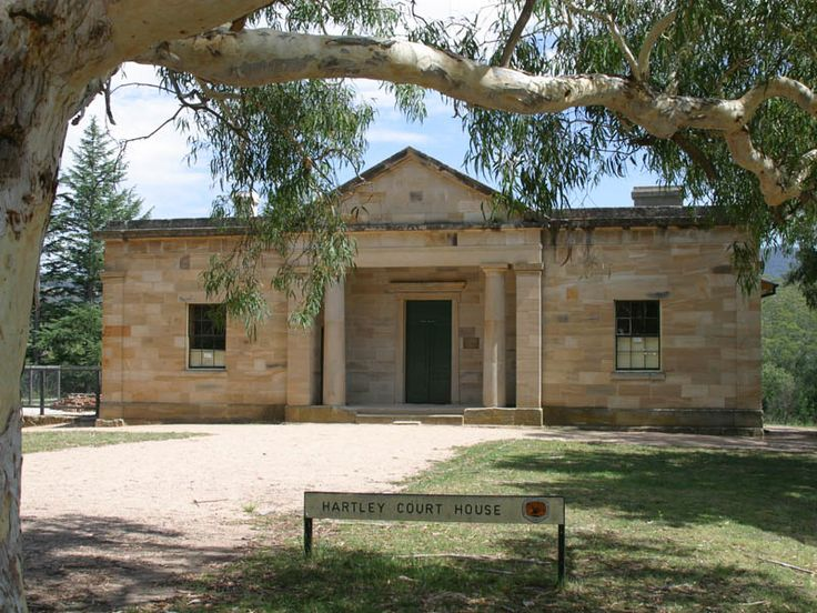 Hartley Courthouse was designed by colonial architect Mortimer Lewis in the Grecian Revival style. Constructed solidly of locally quarried sandstone, it is an imposing building, as it was designed to be impressive.  The three doorways provided entrances for prisoners, the public and magistrates and visitors can examine the cell block that housed prisoners and convicts. Many notorious bushrangers and cattle thieves were kept here inside the cells.