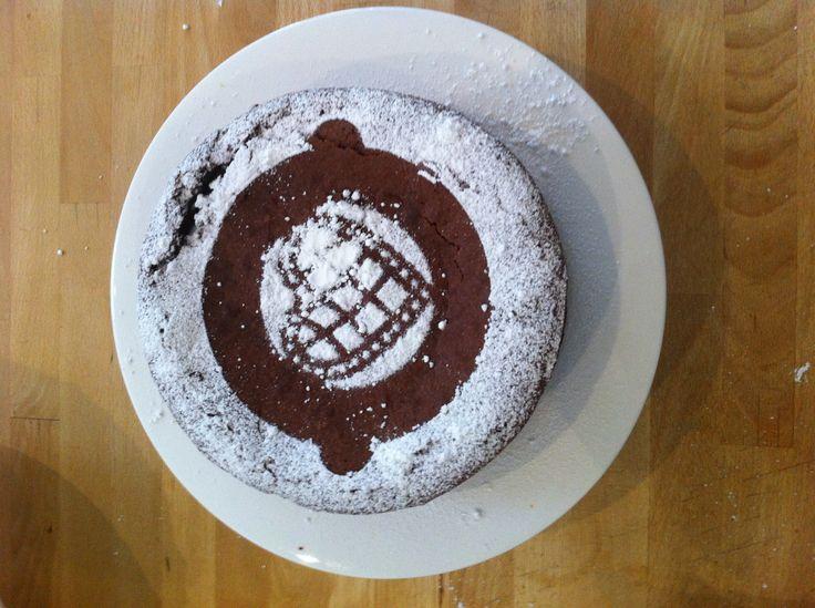 Flourless chocolate cake with icing sugar stencil