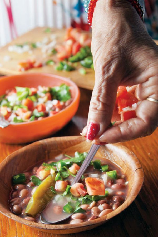 A fresh tomato and jalapeño salsa tops tender pinto beans in this hearty Mexican dish; serve it with warm tortillas and crumbled cotija cheese.