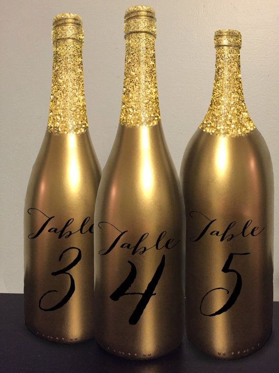 table number wine bottle gold glitter wedding centerpiece