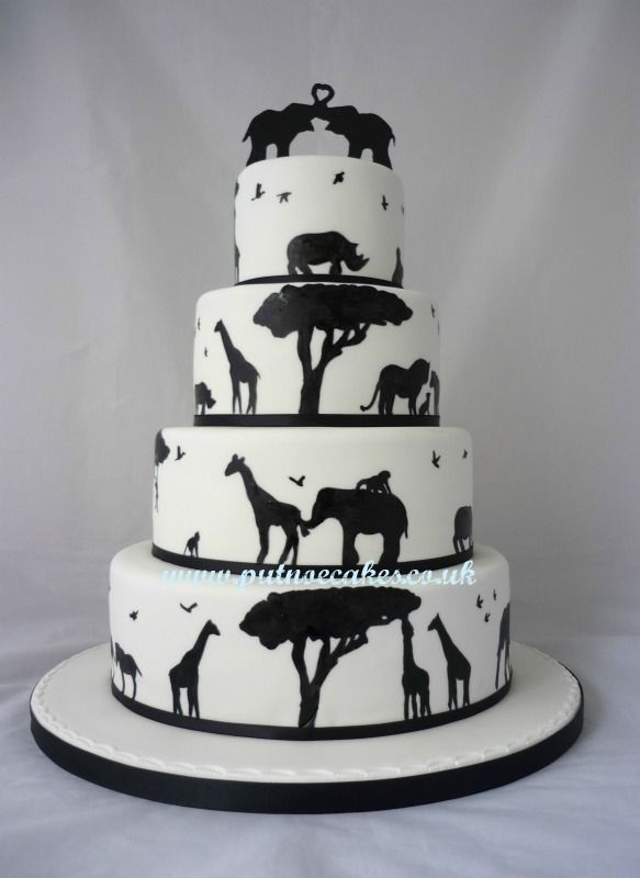 Hand-painted wedding cake with silhouettes of giraffe, rhino, elephants, lions, Zebras, monkeys etc.  A challenge but really pleased with the result.  Delivered to Woburn Safari Lodge.                                                                                                                                                                                 More
