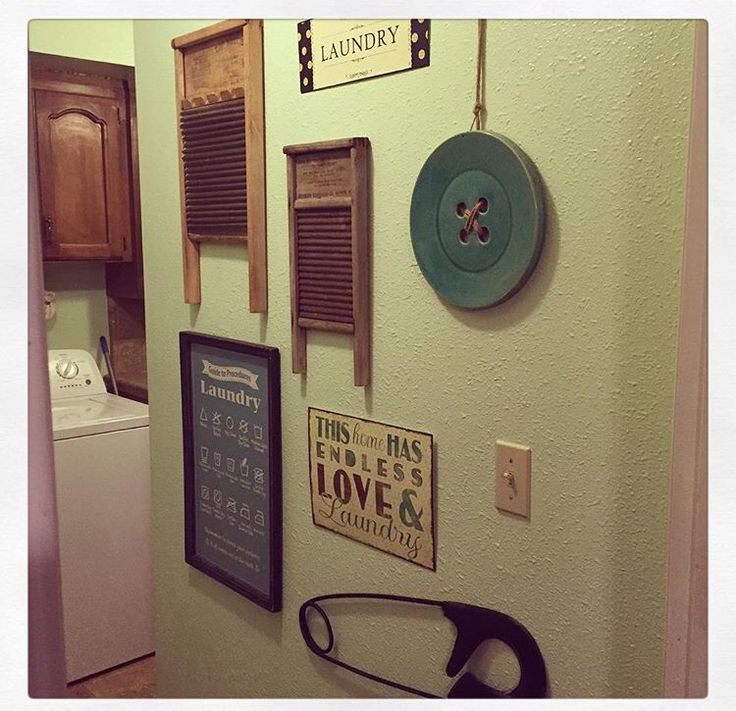 My laundry room wall started with two vintage washboards that belonged to each of my grandmothers. Then I added a large button and safety pin, along with these signs I found at Hobby Lobby!