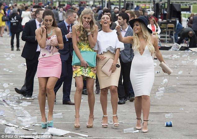 Racegoers leave the course in high spirits after Ladies' Day, Aintree Racecourse...