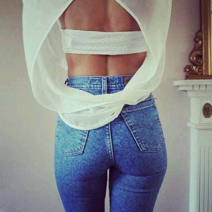 high waisted jeans & open back.