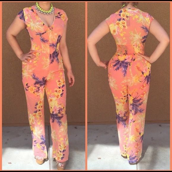 Floral jumpsuit Floral jumpsuit , never used, size medium , stretchy back . Other