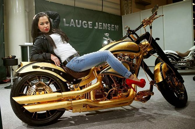 Lauge Jensen has unveiled gold-plated Harley-Davidson which is the world's most expensive motorcycle.  The Danish motorcycle manufacturer has revealed that the customized motorcycle is the world's most expensive motorcycle priced at 535,000 pounds, Metro.co.uk reported.  The special edition Harley-Davidson is on show at the Hamburg Motorcycle Days expo