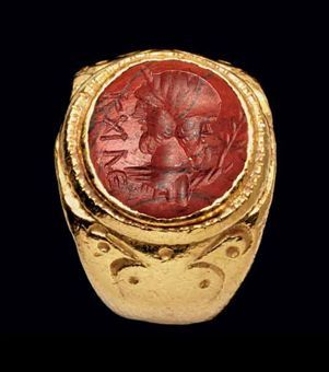 A ROMAN GOLD AND RED JASPER FINGER RING  CIRCA 1ST CENTURY B.C.