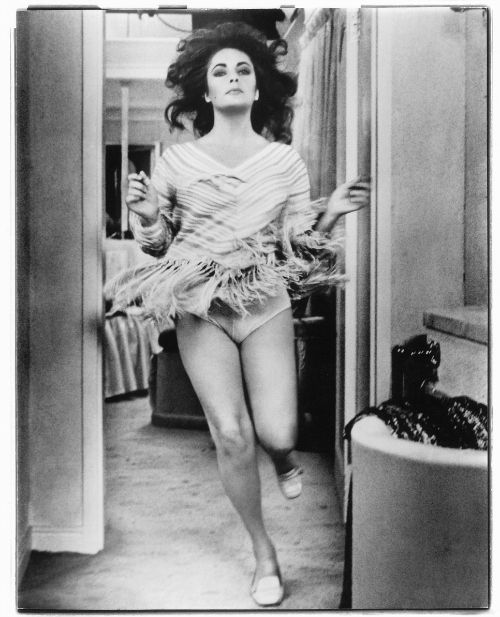 Elizabeth Taylor photographed by Gianni Bozzacchi , 1972 (x)  Gianni Bozzacchi took this photo with a Leica M2 that Elizabeth had just given him. Her scene inX, Y and Zee(1972) called for her to run off camera, and he caught this image from his vantage point backstage. Richard Burton was so taken by the shot that he was moved to compose a short poem about it.