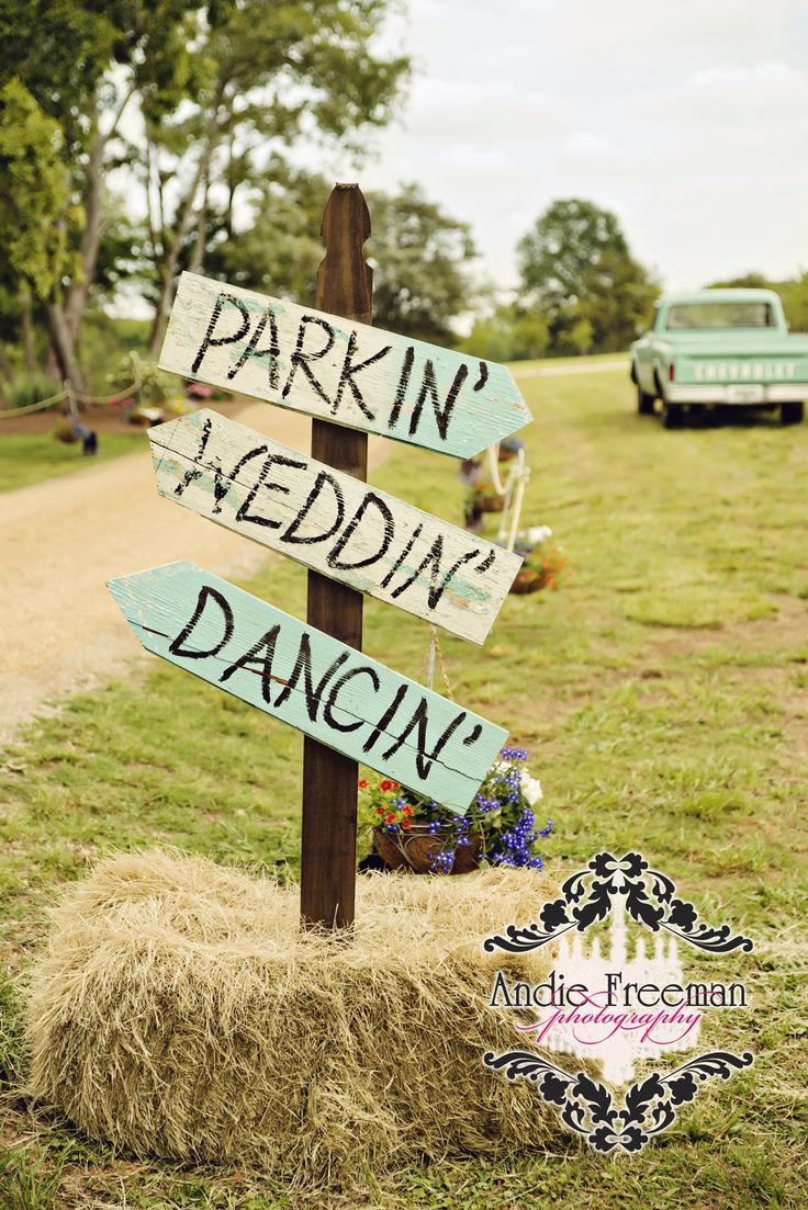 Handmade sign held up with a bail of hay to direct your guests.  Shabby Chic barn wedding. Photography: www.TheAthensWeddingPhotographer.com  Planning, Floral, and Event Design: www.WildFlowerEventServices.com Venue: The Barn on Belmont