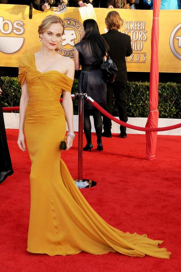 Diane Kruger wearing the most gorgeous mustard gown with a red lip at the SAG Awards