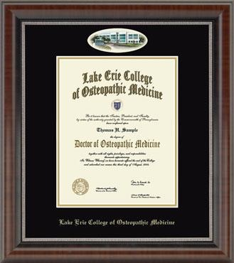Features artwork of Bradenton Building by renowned Eglomisé Designs Inc.® It is presented in double black and gold archival matting in our Chateau frame with a rich French walnut finish and coordinating inner lip accent.    This frame is sized for the current Bachelor's diploma.