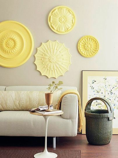 I have a long empty wall. I need to do this in shades of green. Inexpensive ceiling medallions are meant to trim out a hanging light fixture, but they also make an interesting wall display (especially if you can find vintage versions!). I love the varying shades of yellow and how the intricate patterns add a nice texture to the space in this example from Better Homes & Gardens.