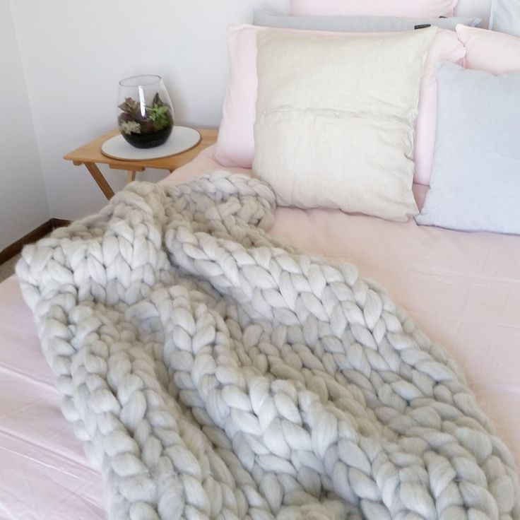 Buy the wool to arm knit your own super chunky wool throw (or use XXL needles).  Pure NZ wool chunky knit kits available online now. Affordable, delicious candy for your couch.
