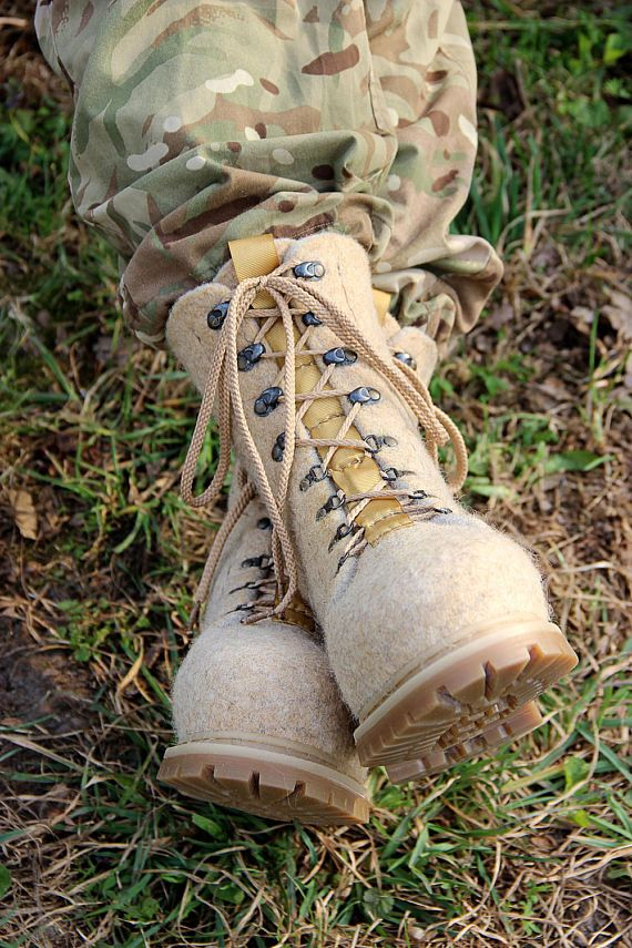 Kaenugardur #1  Personalized wool-felted laced winter boots for men in military tactical style. Extra comfortable snow boots with stitched polyurethane soles. Any color, any size. Custom boots for order!  Product description:  Our felt shoes are totally handcrafted of 100% pure wool with warm water, soap, love and care. The sole, made of polyurethane, is firmly glued and stitched by strong natural waxed nylon-6 line. Felted shoes are extremely solf, light, comfortable and long-wearing. It…