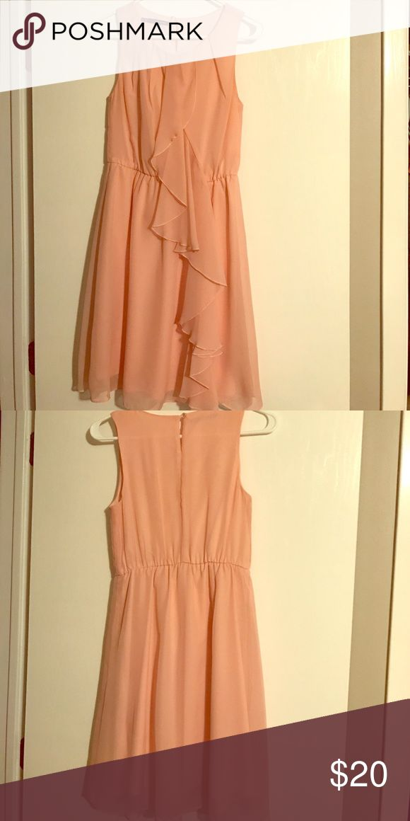 Dress - great for attending a wedding Great float material with elastic around the waistband. This dress is light pink in color. Maurices Dresses