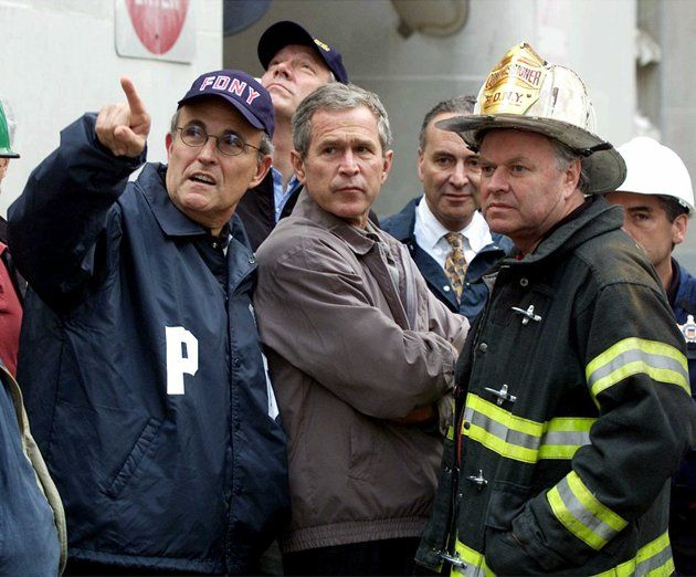 As rescue efforts continue in the rubble of the World Trade Center, President Bush greets firefighters at the site during a tour of the devastation, Friday, September 14, 2001. Bush is standing on a burned fire truck. Bush toured the disaster site on foot after getting a helicopter view of the devastation. (AP Photo/Doug Mills)President Bush and first lady Laura Bush observe a moment of silence after laying a memorial wreath in a reflecting pool at ground zero Sunday, Sept 10, 2006…