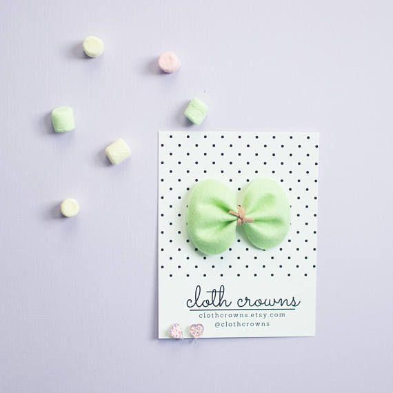 This listing is for one merino felt bow: +granny smith green in classic size (approximately 3 inches). A bright cool mint, perfect for spring <3 Suede cord is also faux & vegan! Headbands are high quality nude nylon, run resistant, snag resistant & smooth. One size fits most from
