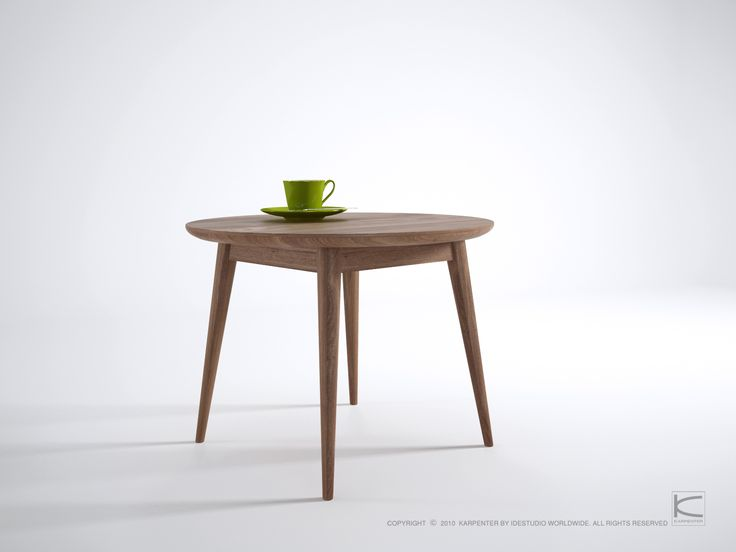Round dinning table made out of reclaimed teak wood.