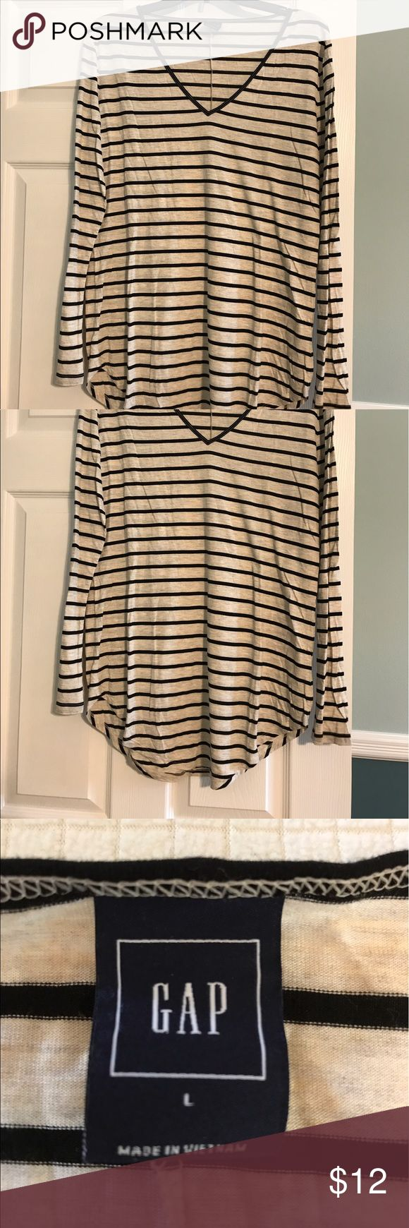 Long sleeved black and white long tshirt Longer black and white striped top that can easily be worn with leggings. Vneck top. GAP Tops Tees - Long Sleeve