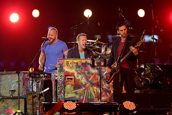 (R-L) Guy Berryman, Chris Martin and Jonny Buckland of Coldplay perform during the closing ceremony on day 11 of the London 2012 Paralympic Games at Olympic Stadium on September 9, 2012 in London, England. (Photo by Peter Macdiarmid/Getty Images)