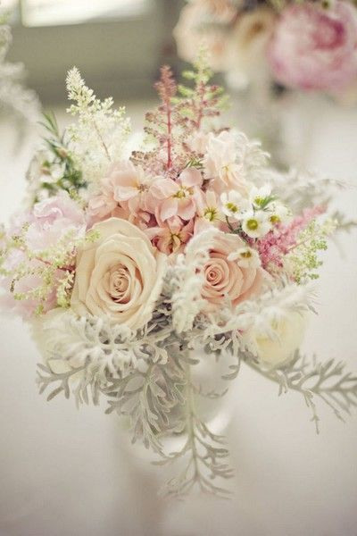 "Vintage Pastel Centerpiece...also love the use of the white ""greenery"" that is peaking out beneath the roses. This would be a great leaf to add to any beachy bouquet. It reminds me of something you'd find under the sea!"