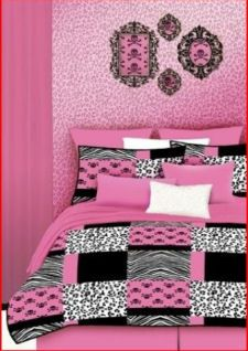Teen girl bedroom with hot pink zebra girly skull decals framed in black frames on a wall covered in and cheetah print wall paper