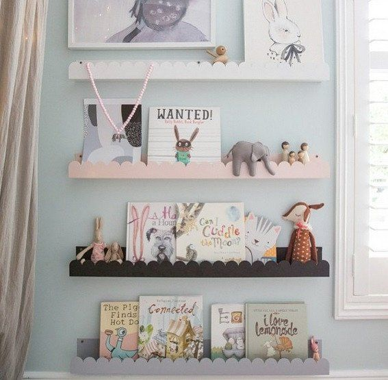 A gorgeous powder coated steel shelf by Wood Rabbit featuring a cloud cutting on the front. A gorgeous addition to any room for displaying books.