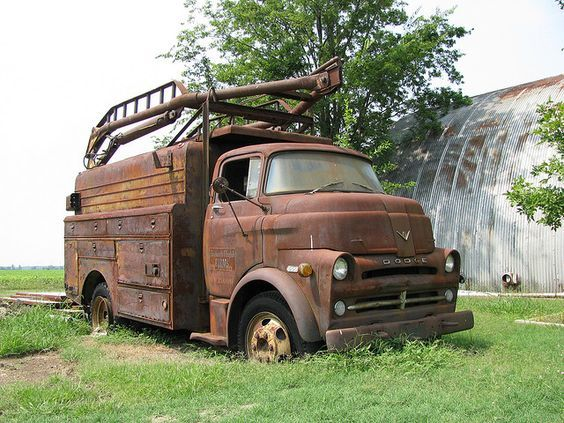 Incredible Old Tow Truck Barn Find: Back in its day, I bet this old Dodge tow truck had all of the bows and whistles working trucks had way back in the, I suppose, the 1950's. Dang, just look at all of the drawers and lockers this beefy utility truck has. And the length of its towing bar / boom is awe inspiring.