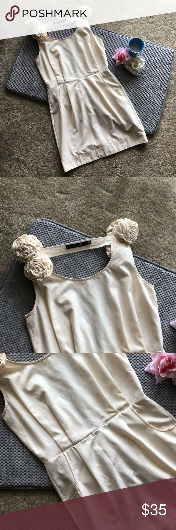"""Ark & Co Cream Cocktail Dress Cream colored ark & co. cocktail dress. Features fun flower details, pockets, and a sexy plunging back. Perfect for prom!  Excellent used condition. Some loose stitching on left side, and missing one flower on front left side (barely noticeable).   -Size M. Approximate measurements taken laying flat: Bust 16.5"""" Waist 14.2"""" Hips 18.5"""" Length 33""""  -Shell polyester 92%, spandex 8% Lining 100% polyester Ark & Co Dresses Mini"""