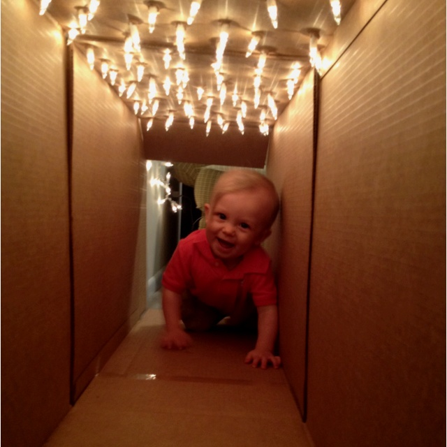 Poke holes on top of a cardboard box, insert lights, and you have a tunnel your little ones will love to play in!
