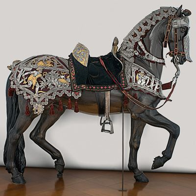 Attributed to Kolman Helmschmid, German, 1470–1532  Equestrian Armor of Maximilian I, Augsburg, c. 1517–1518  openwork, embossed, etched, and gilt steel; fabric and leather  Patrimonio Nacional, Real Armería, Madrid