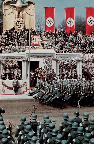 Soldiers goose-step past the Führer in honor of Hitler's 50th birthday, April 20, 1939. Less than five months later, on September 1, the Third Reich's forces invaded Poland.