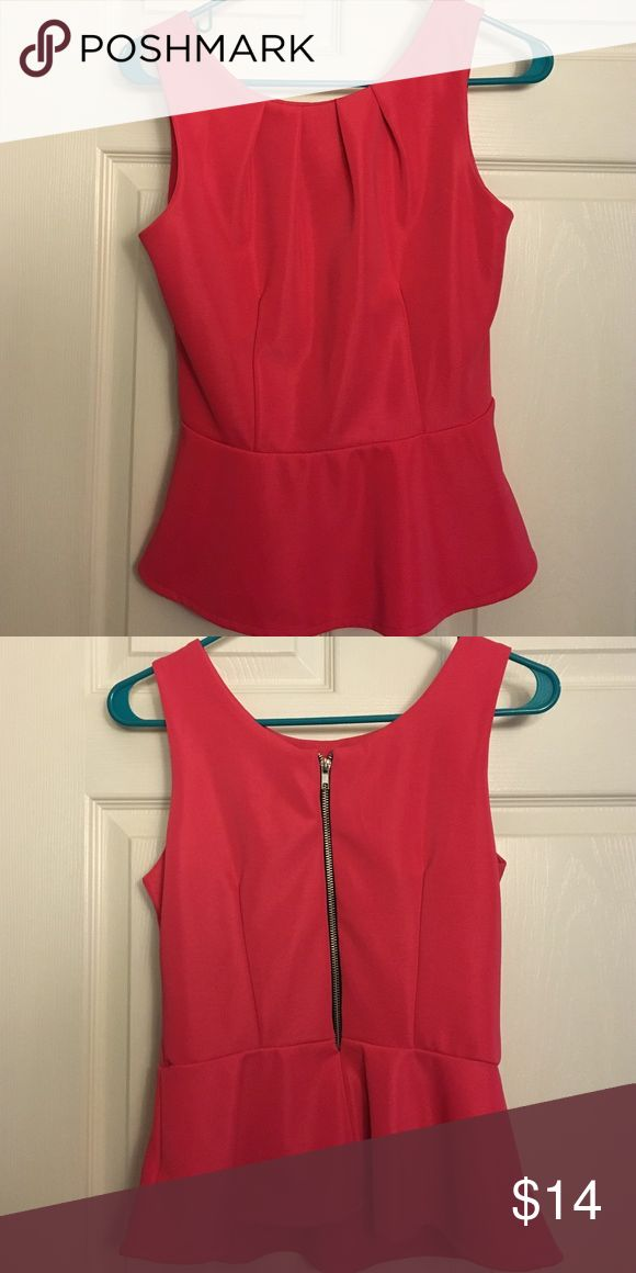 Pink peplum top Pink peplum top with zippered back. Great for dressing up a bit but can also be worn more casually. 97% polyester, 3% spandex. Worn twice, in great condition. Forever 21 Tops