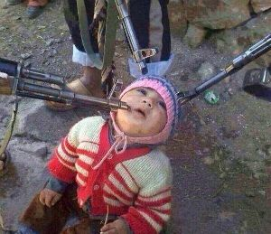 A child is photographed, waiting to be killed by militants. ISIS uses these images to terrorize others and to glorify their spree of terror.... Please get your leaders to sponsor & help these children who r Christian escape from ISIS Islamic terrorists now!