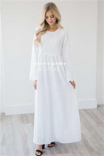 b143073c61 This white dress features lace detail across the bodice