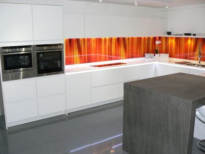 bespoke handleless kitchens which are available in absolutely any ral colour any veneer and in