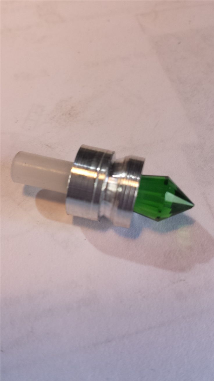 Custom machined crystal lightsaber kill key.
