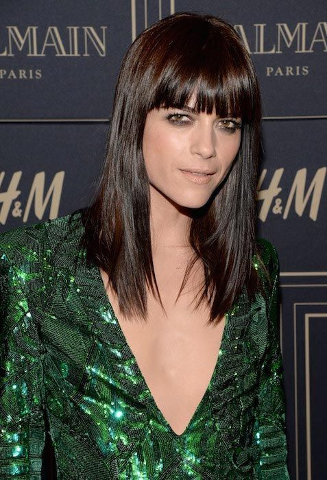 Selma Blair showed off her lean figure in a deep-plunging sequined green mini dress, while attending the Balmain x H&M Los Angeles VIP Pre-Launch held in West Hollywood, California on November 4, 2015....