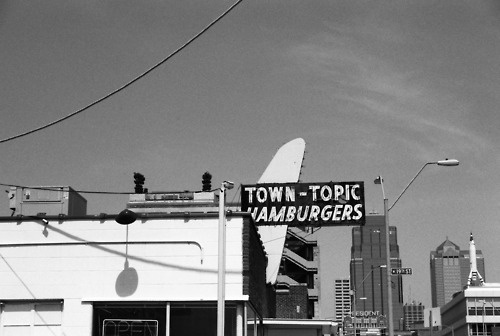 Town Topic - best greasy dive I know! Double bacon cheese burgers. Awesome onion rings. Delicious pie! What more could a girl want? Located at 2021 Broadway Street in Kansas City